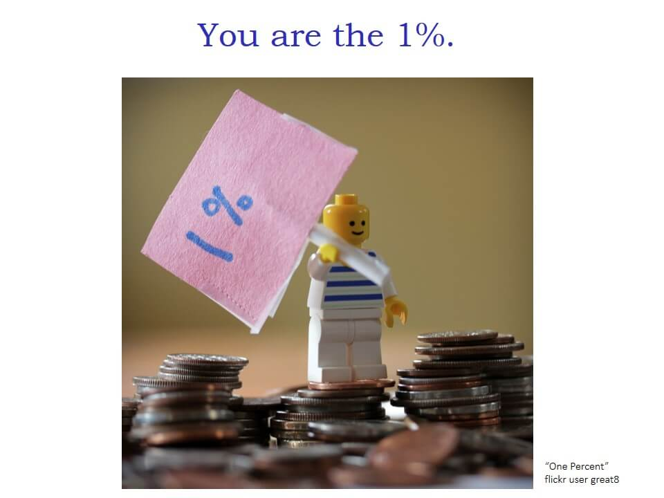 """You are the 1%"" and a photo of a Lego mini-figure holding a 1% sign and standing with piles of coins."